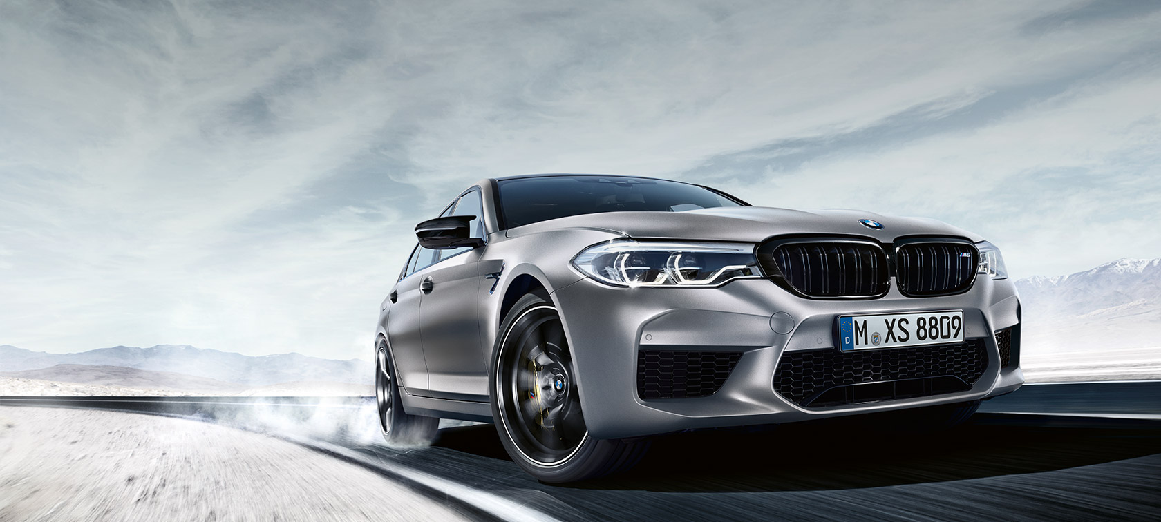 BMW M5 Competition three-quarter front view.