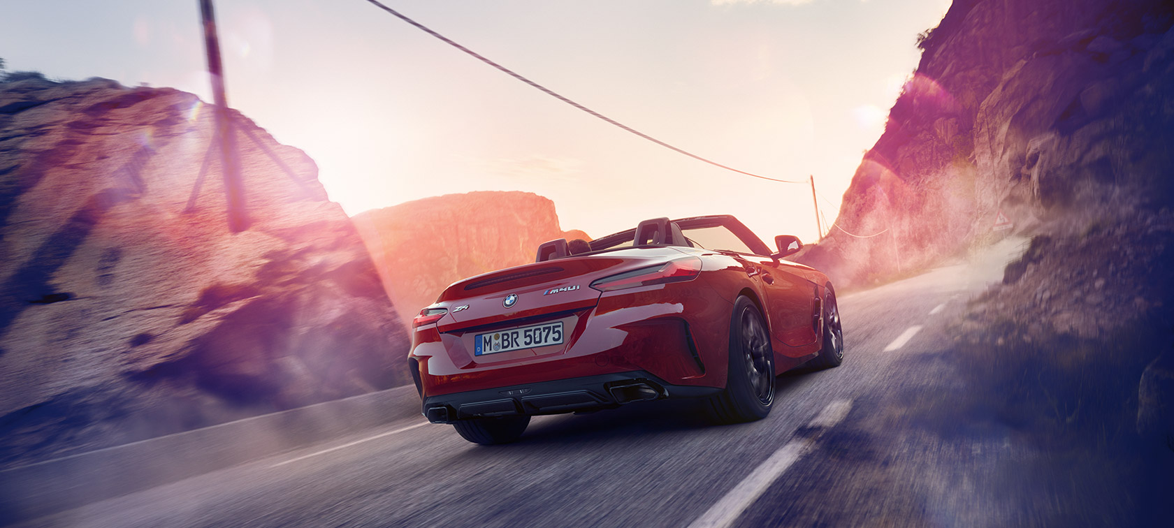 BMW Z4 Roadster driving through mountains